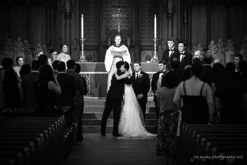 Angel lovingly embraces her dad as he gives her away at the altar at Duke Chapel.