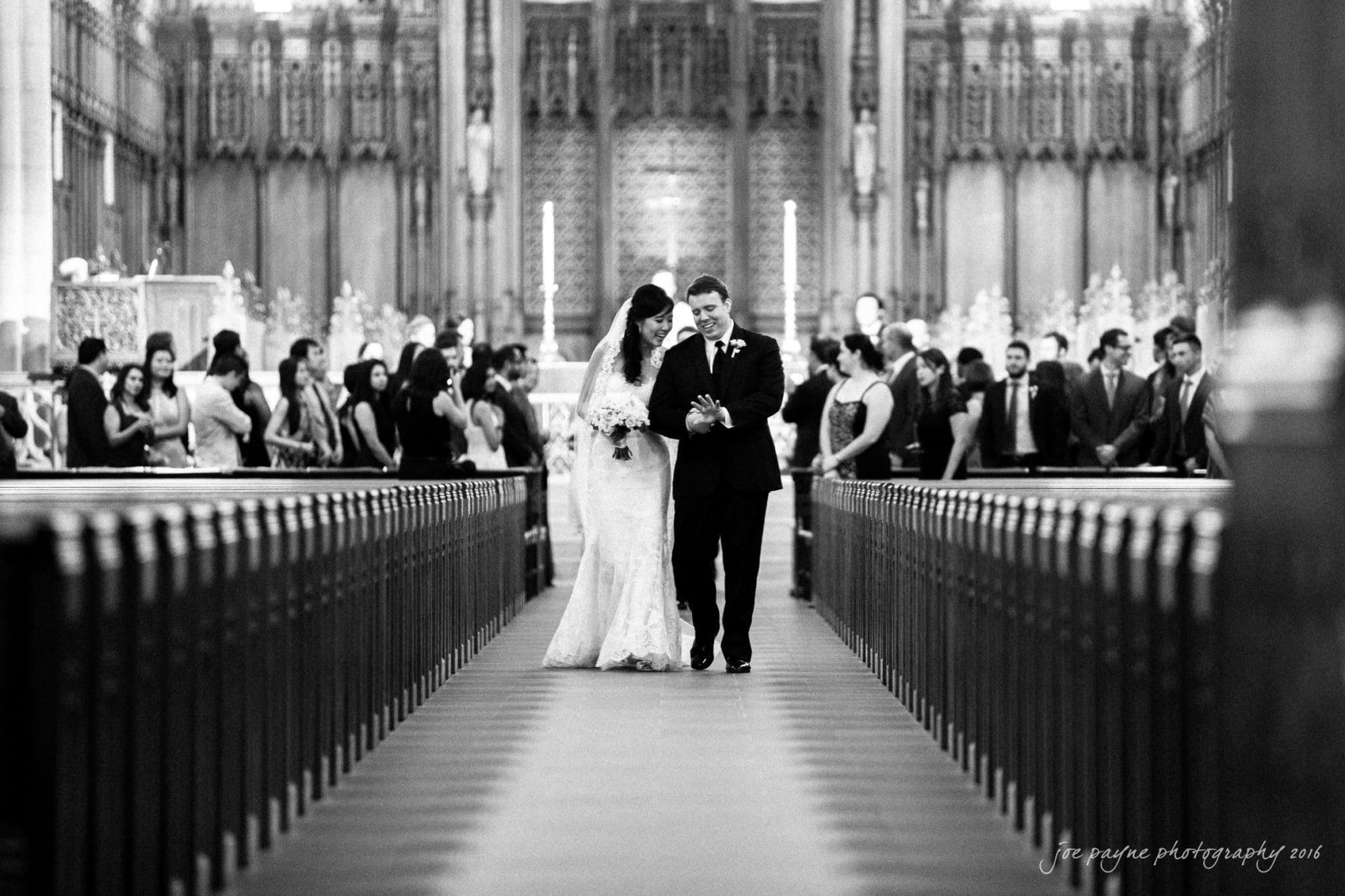 duke chapel & carolina inn weddings – angel & Jeff recessional looking at ring by Joe Payne