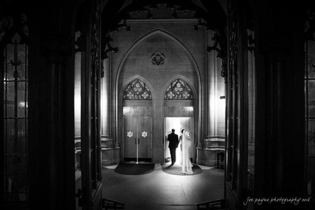 Light streams in through the doors of Duke Chapel.
