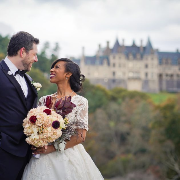 Biltmore Estate Wedding Photography - Mixed Race could with Biltmore House in Distance