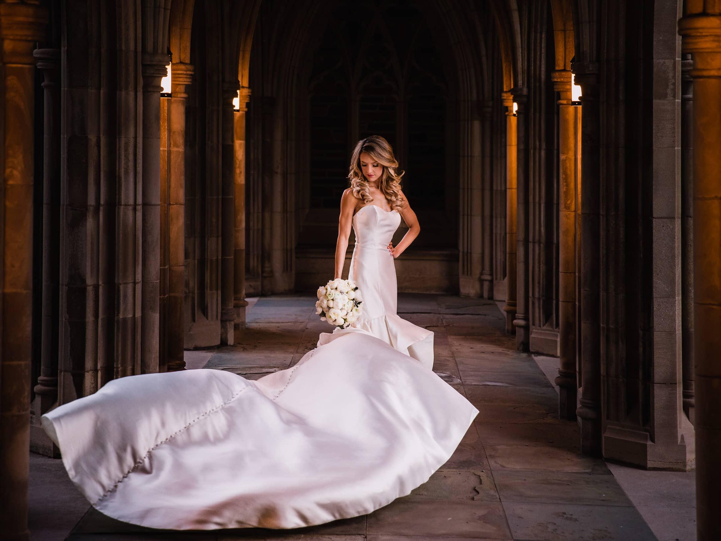 Color Duke Chapel Wedding Photo of Bride in Arcades on her wedding day by Joe Payne