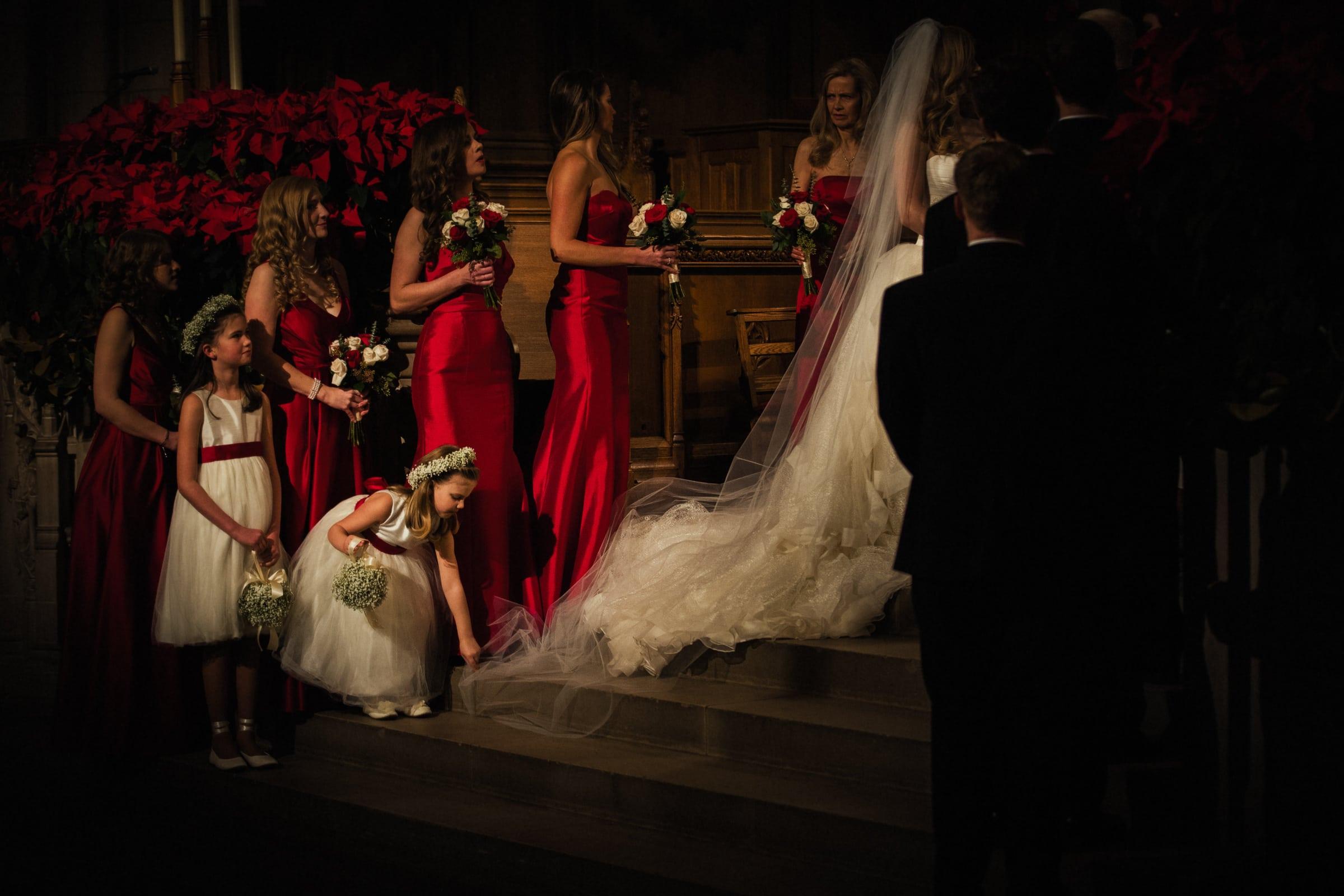 Duke Chapel Wedding Photo - Flower Girl Fixes Dress