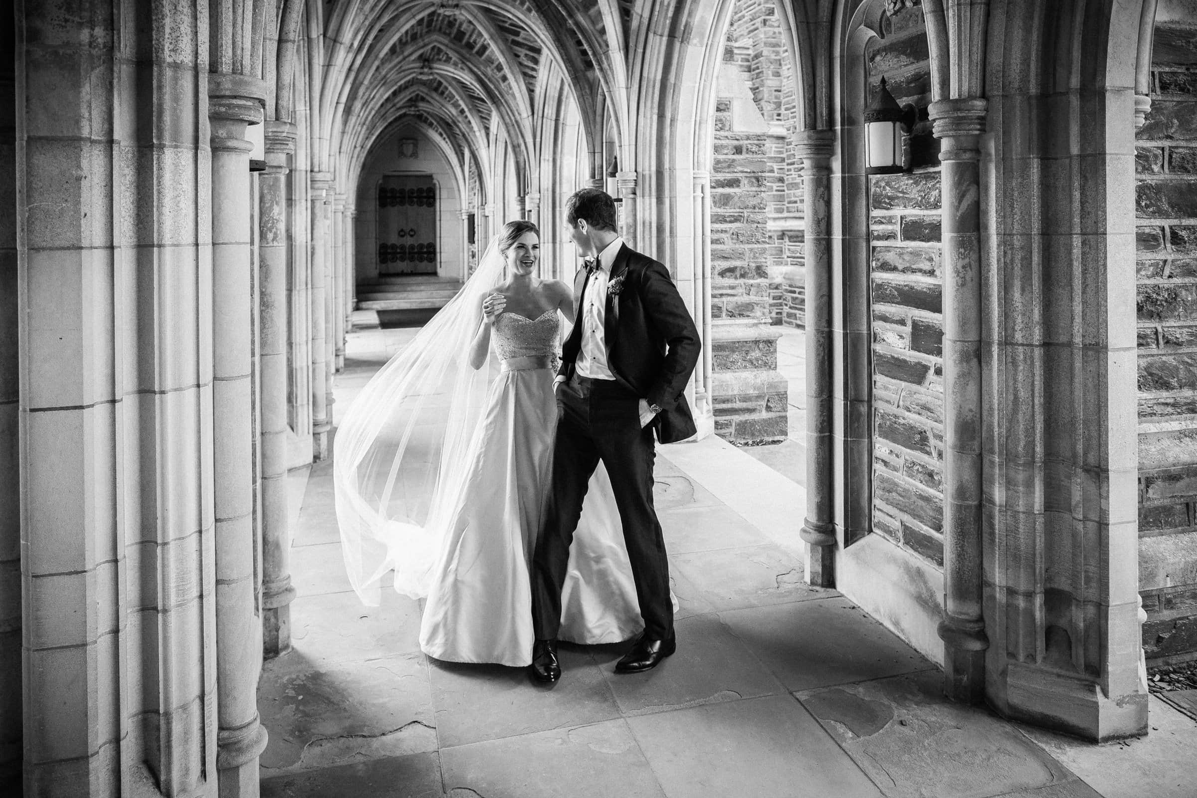 B&W Photo of First Look in Arcades at Duke Chapel Wedding by Joe Payne Photography