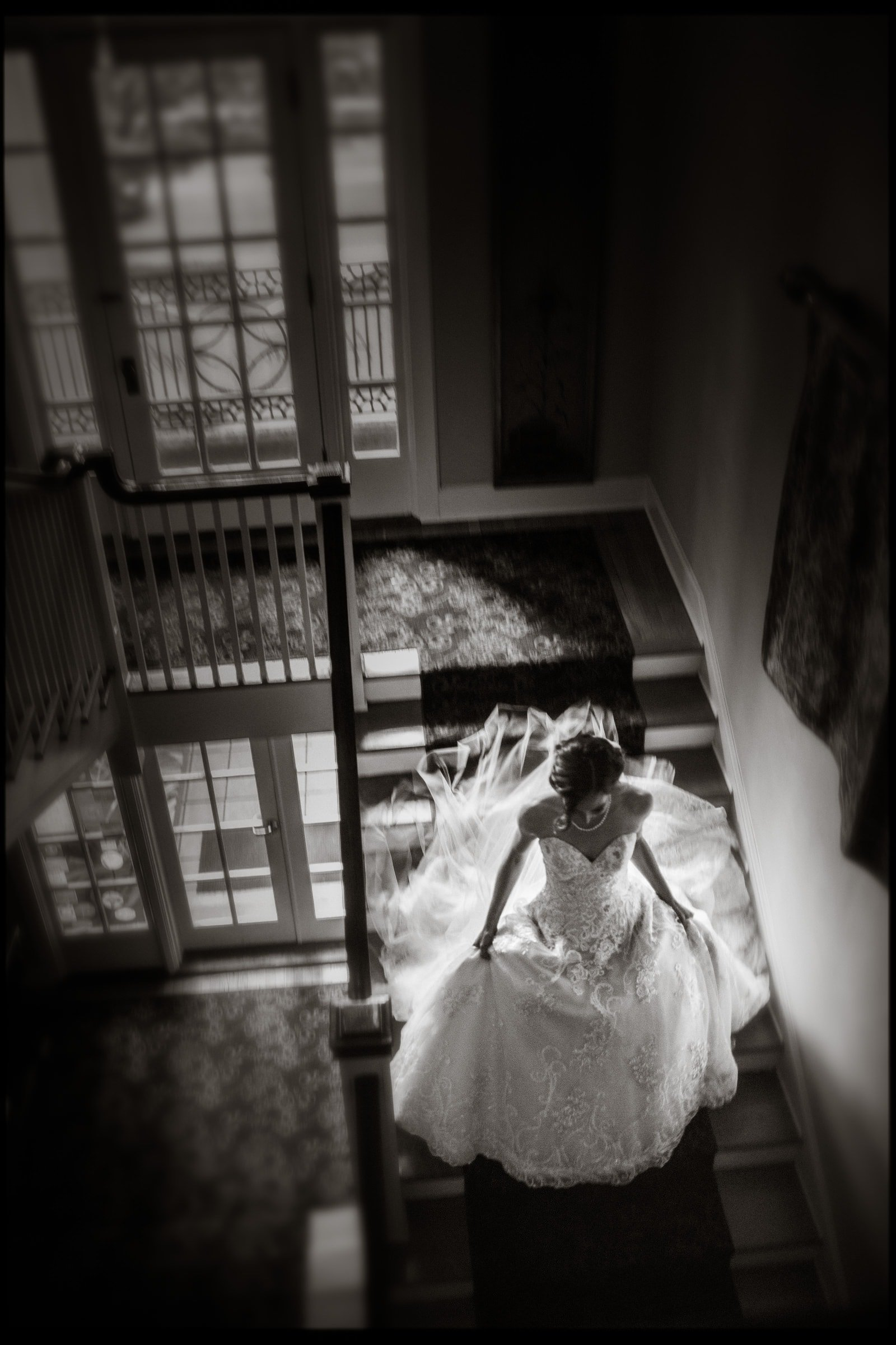 B&W Wedding Bridal Portrait of Bride on stairs at Kings Daughters Inn Durham NC