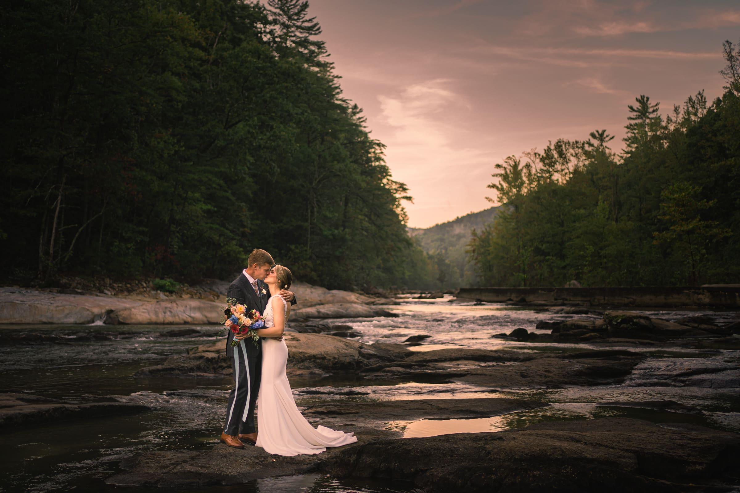 Couple Kissing at Sunset at Brown mountain Beach Resort by NC wedding photographer Joe Payne