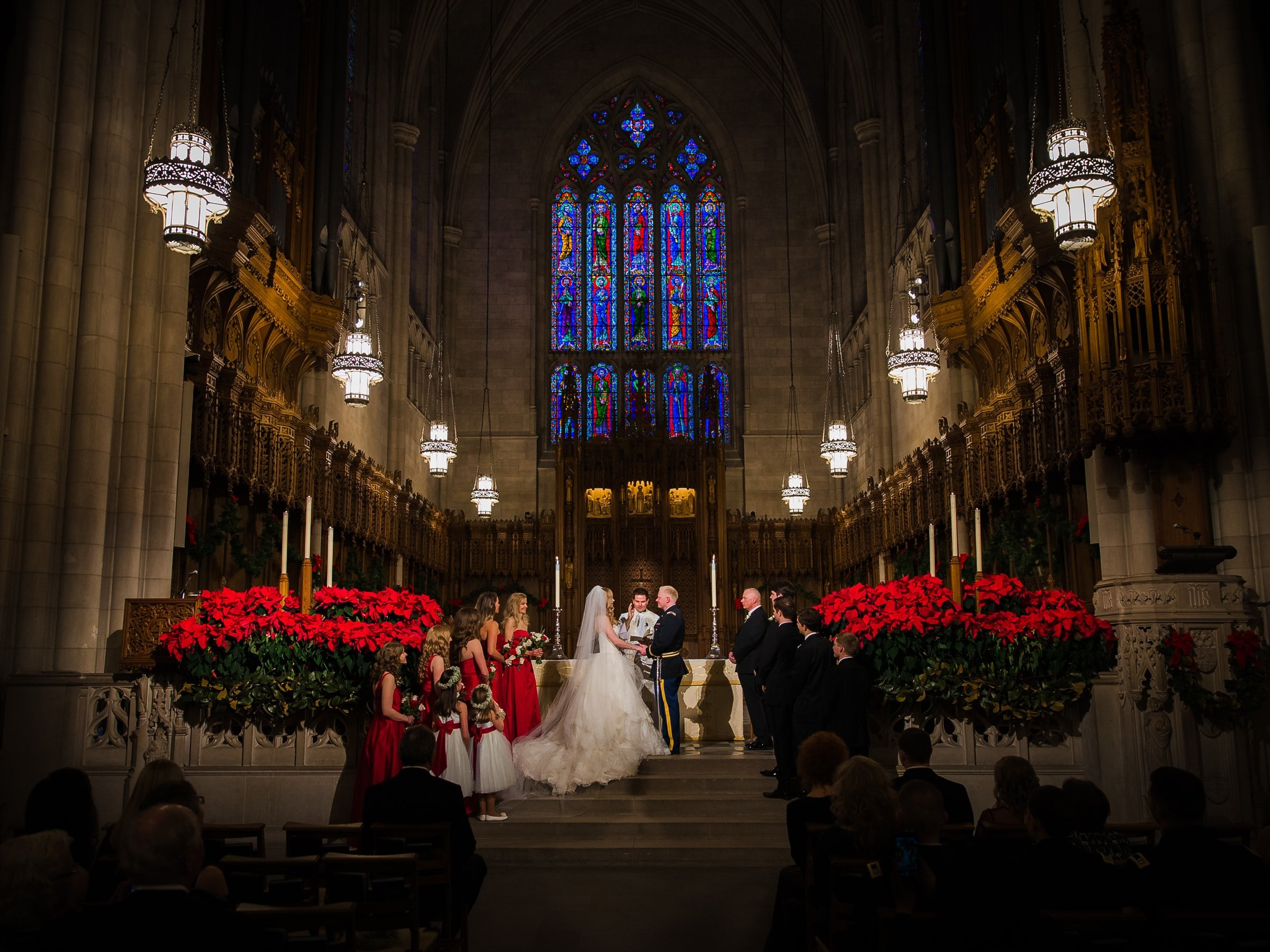Duke Chapel Weddings - Christmas Ceremony with Red Poinsettias & Stained Glass Window