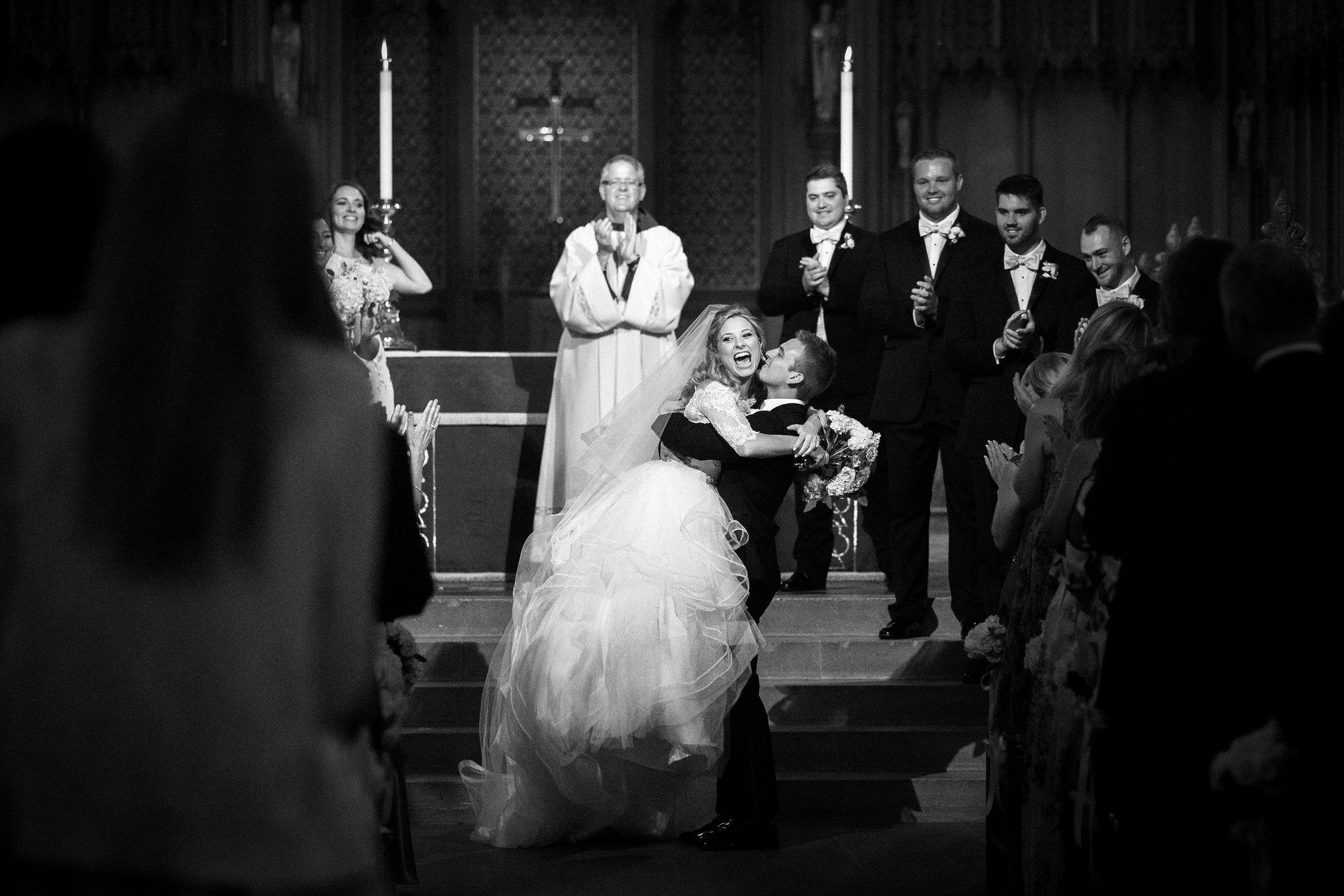 Duke Chapel Wedding Photo of Newlywed Bride & Groom Celebrating by Joe Payne Photography