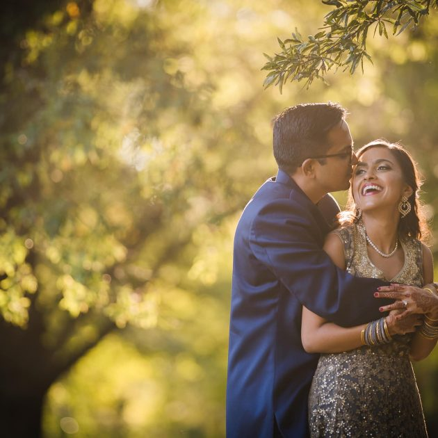 Wedding Portrait of Indian Couple backlit against trees by Joe Payne from Swathi & Karthik's Renaissance Hotel Raleigh Wedding