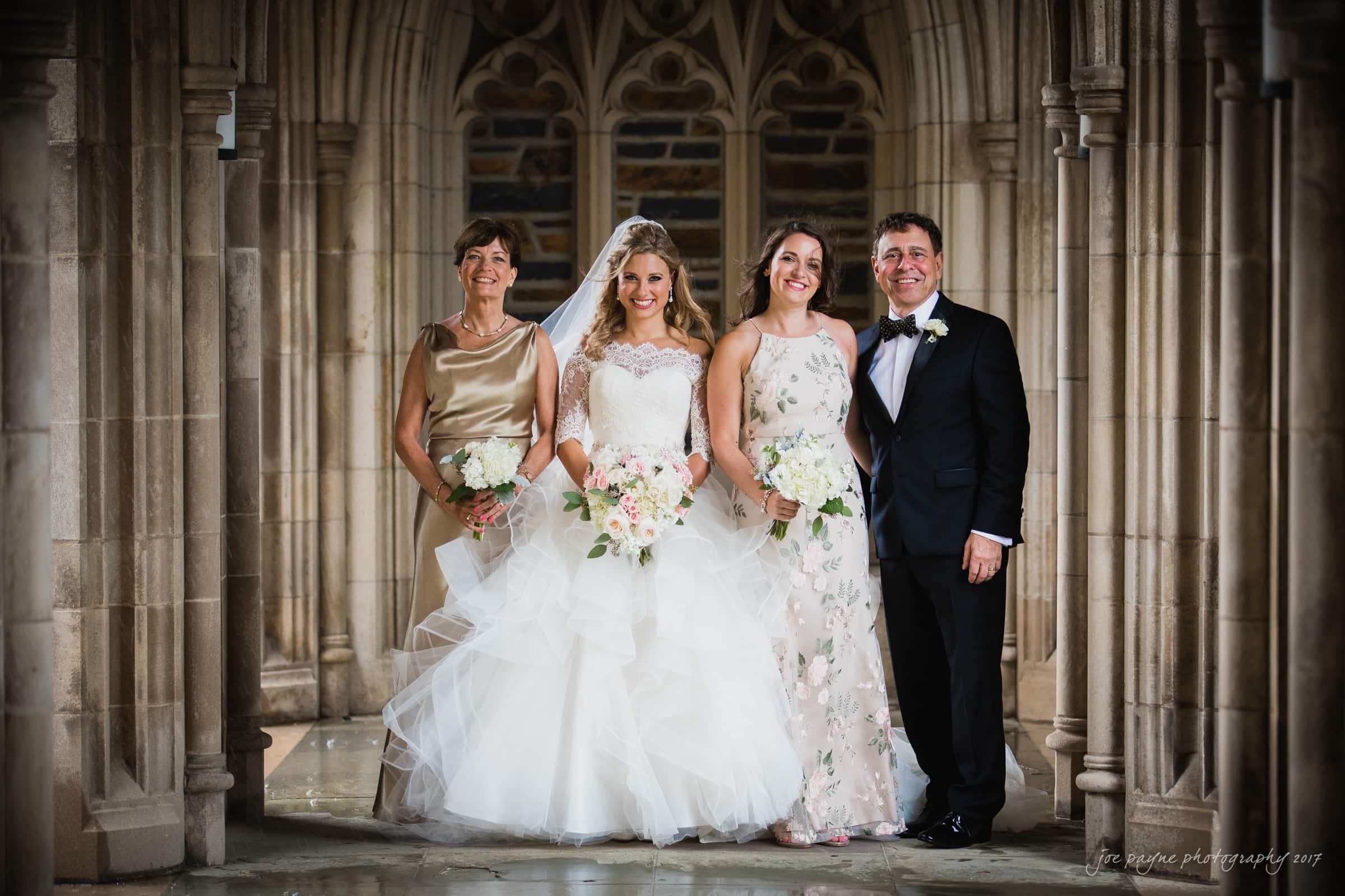 duke chapel wedding photos - bride and family in arcades