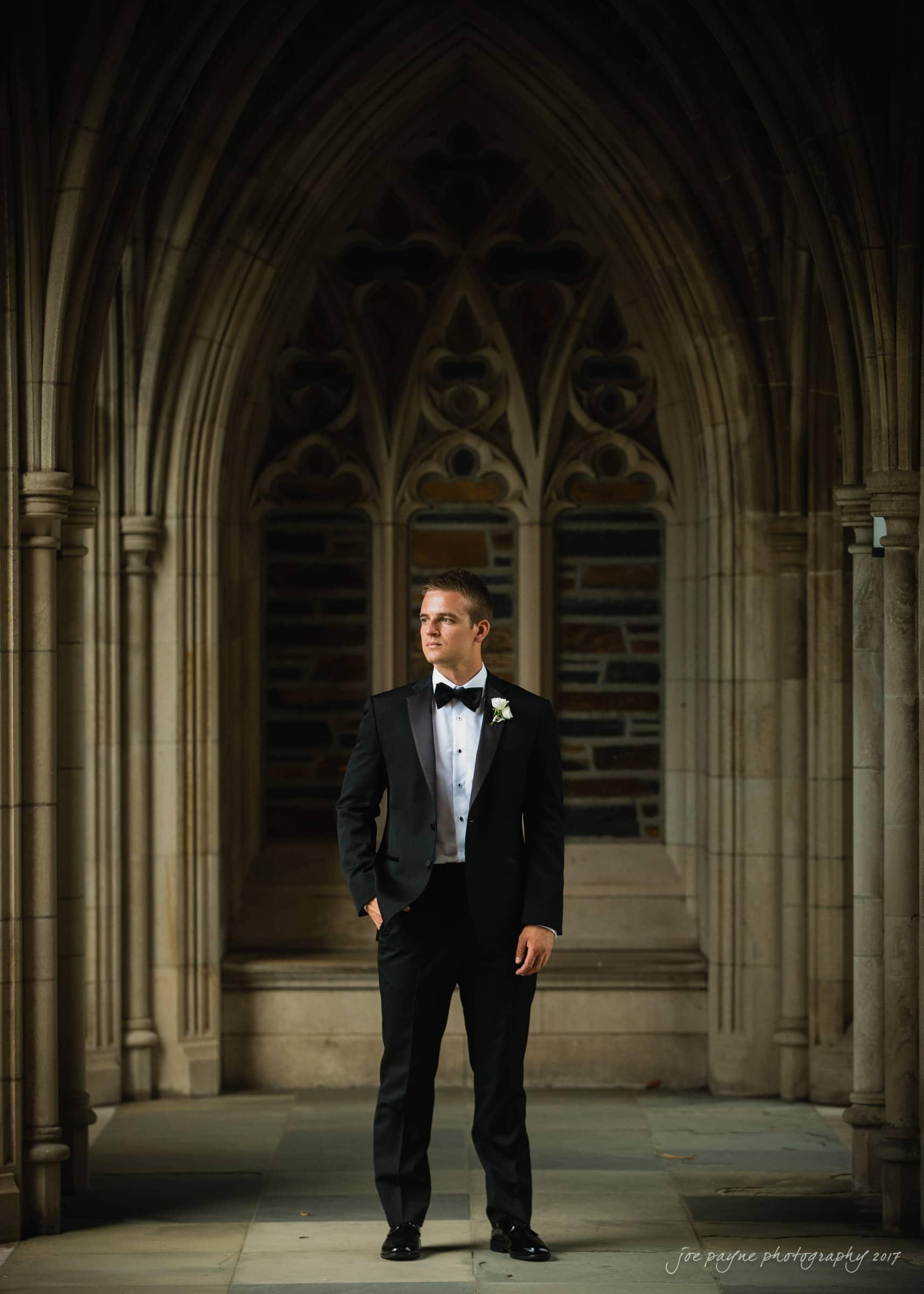 duke chapel weddings - groom in arcades
