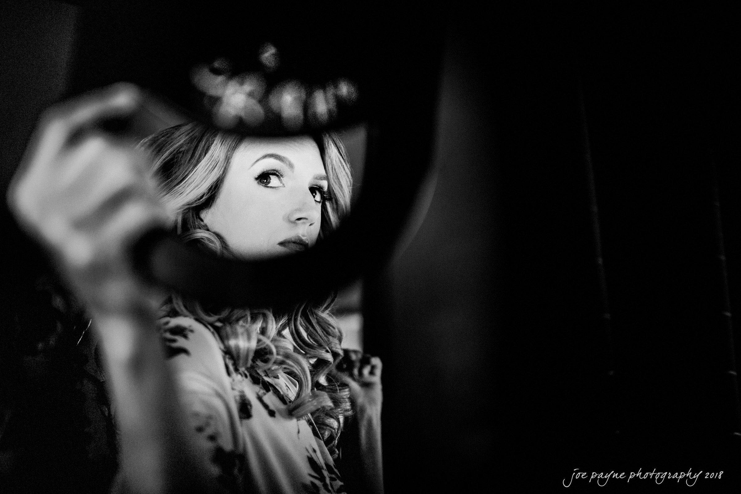 B&W photo of bride checking makeup at 21c