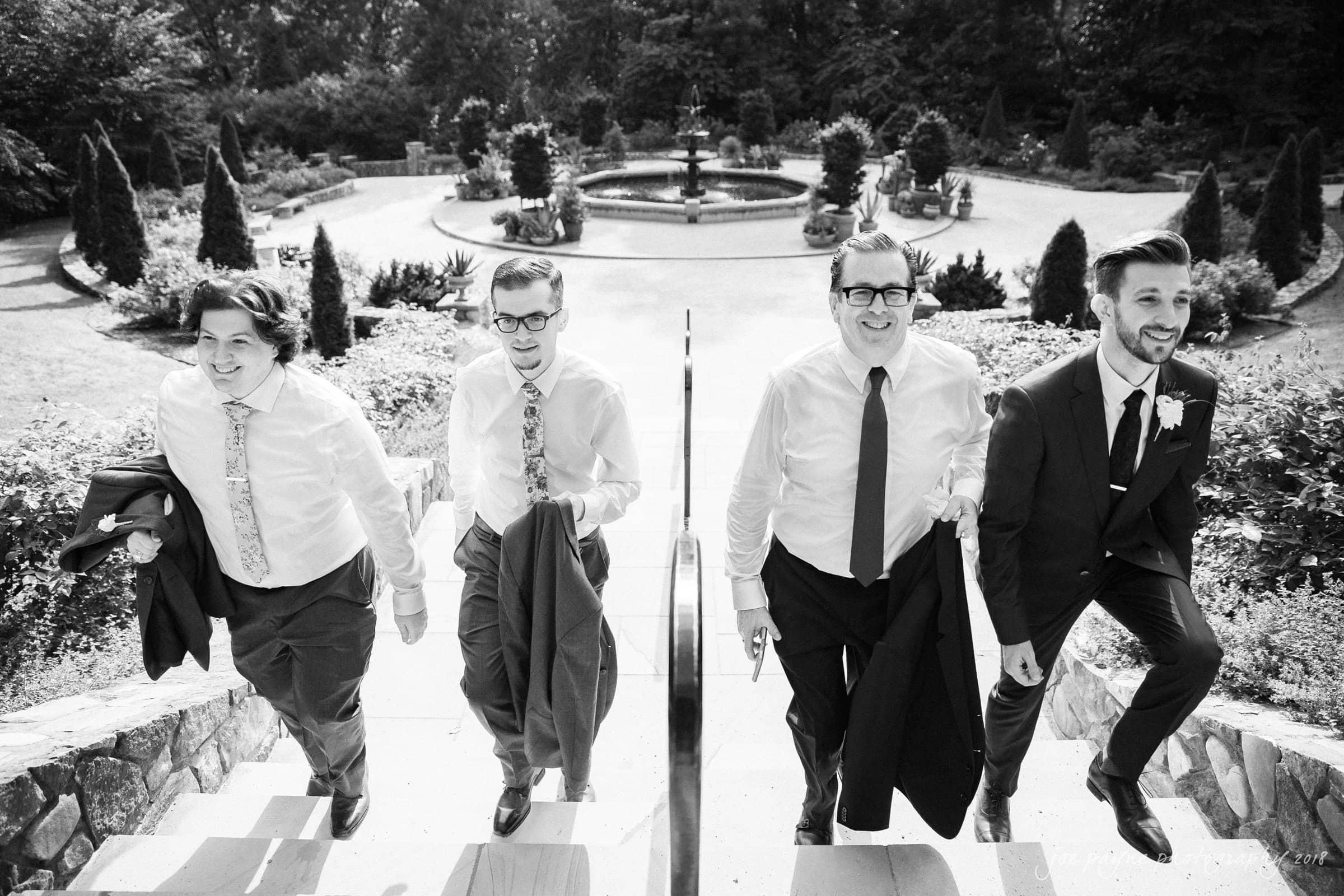 Duke Gardens Wedding - Ricky and brothers walking B&W