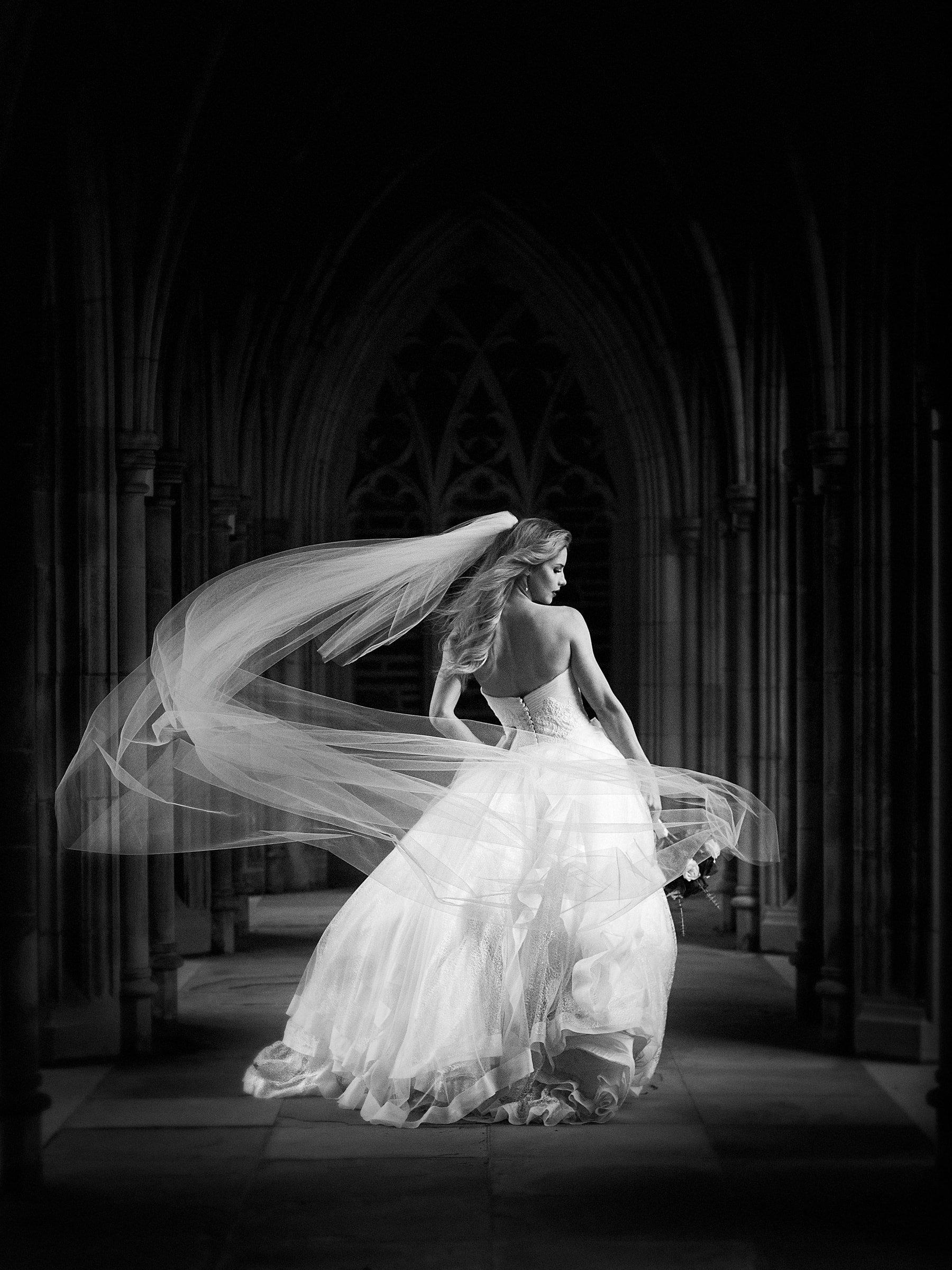Duke Chapel Weddings - B&W Bridal Portrait in Arcades with Veil