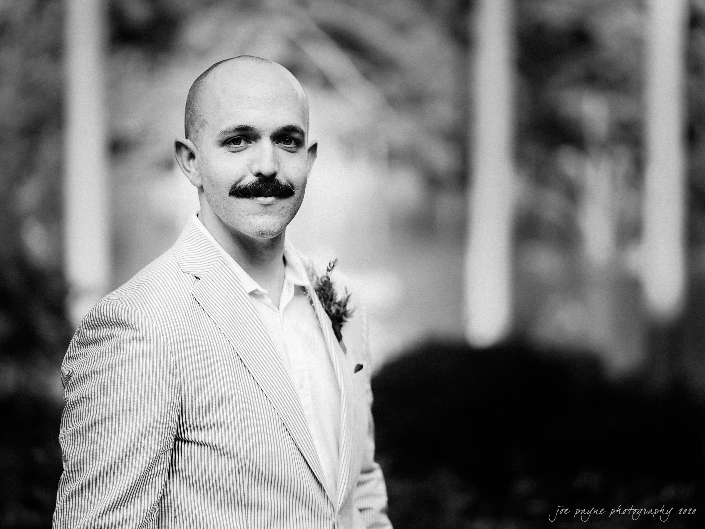 intimate umstead wedding - groom portrait b&w