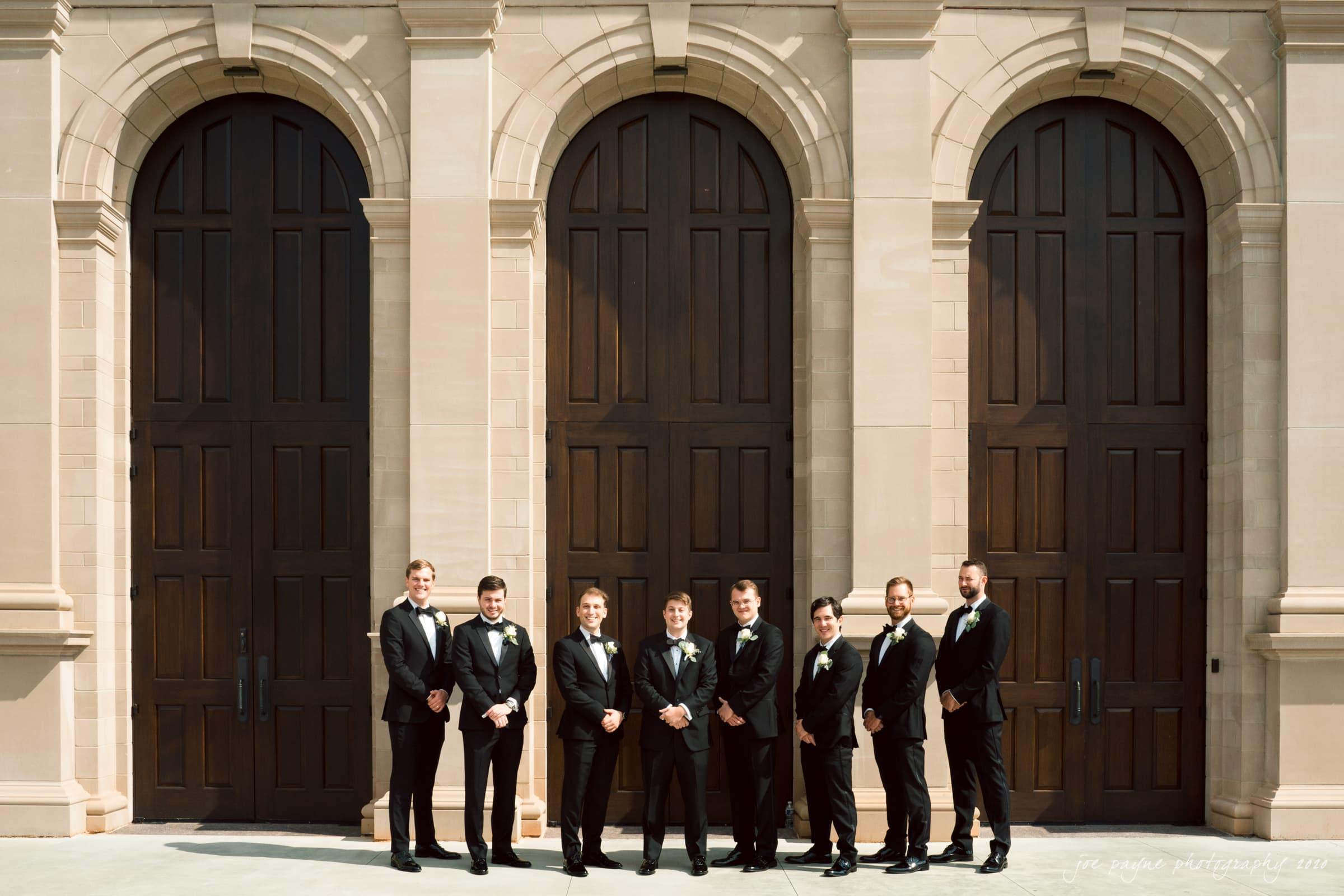 holy name of jesus & angus barn wedding - groom & groomsmen façade