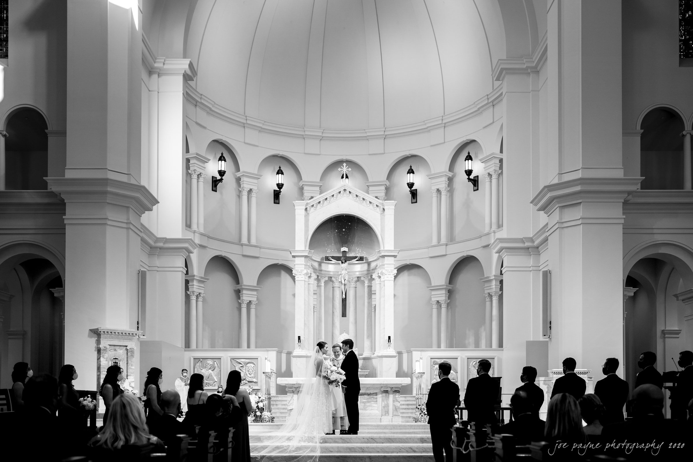 holy name of Jesus wedding in B&W - couple at altar with Most Reverend Michael F. Burbidge