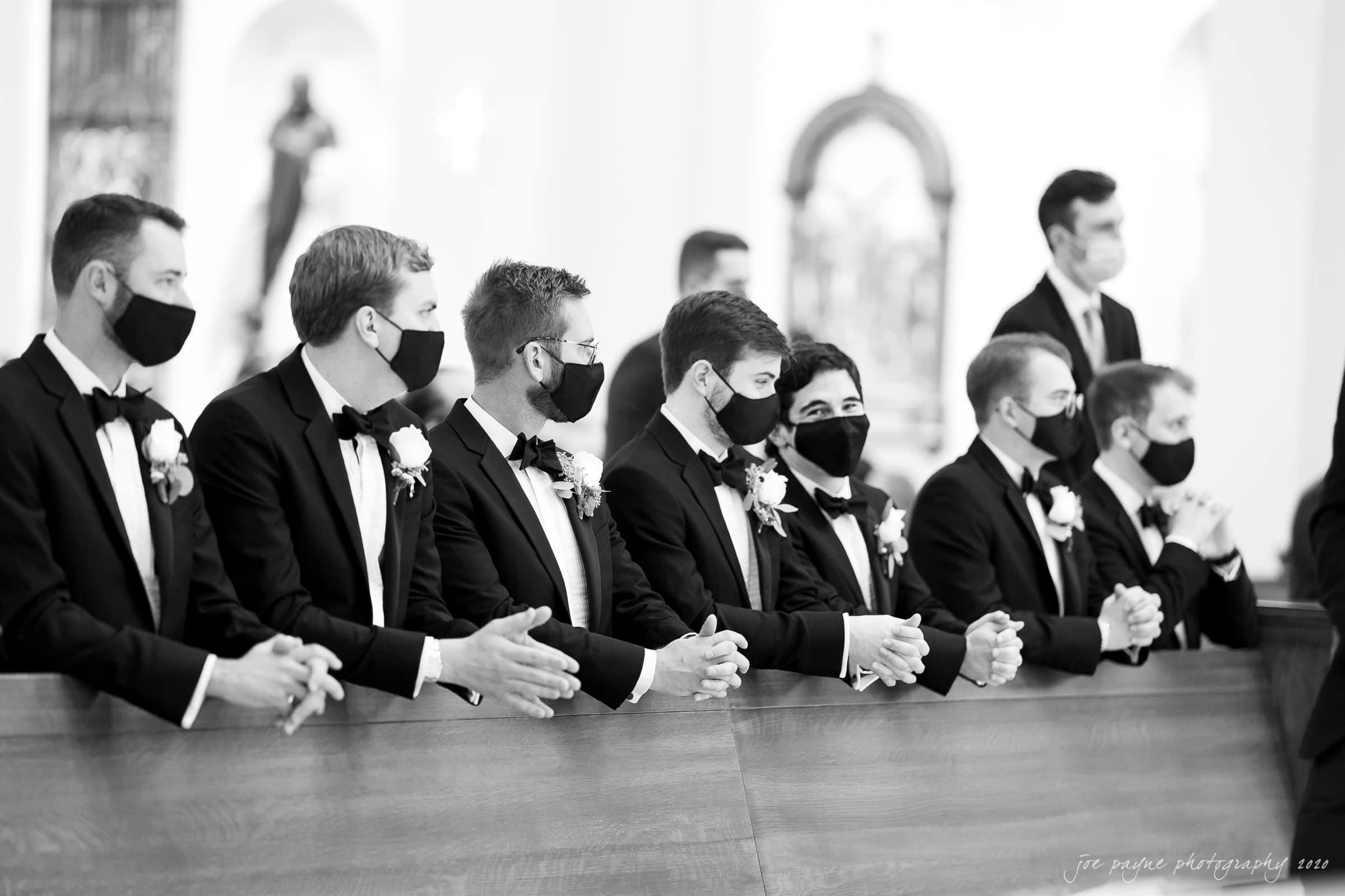 Holy Name of Jesus wedding laughing groomsmen in B&W during covid