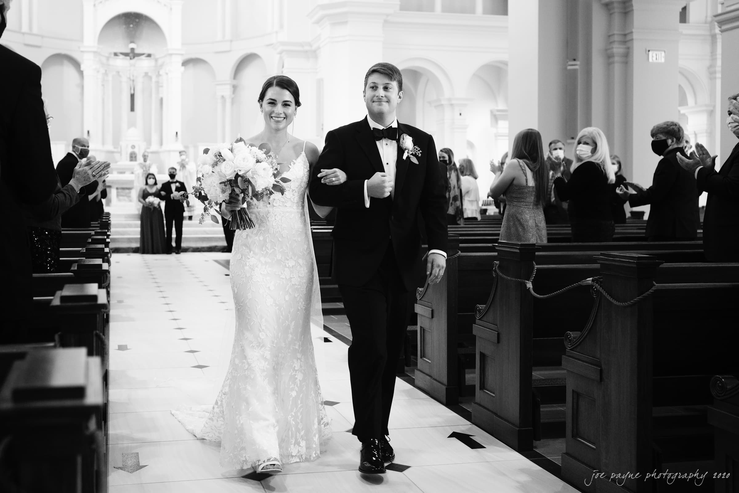 Holy Name of Jesus wedding couple recessional in B&W