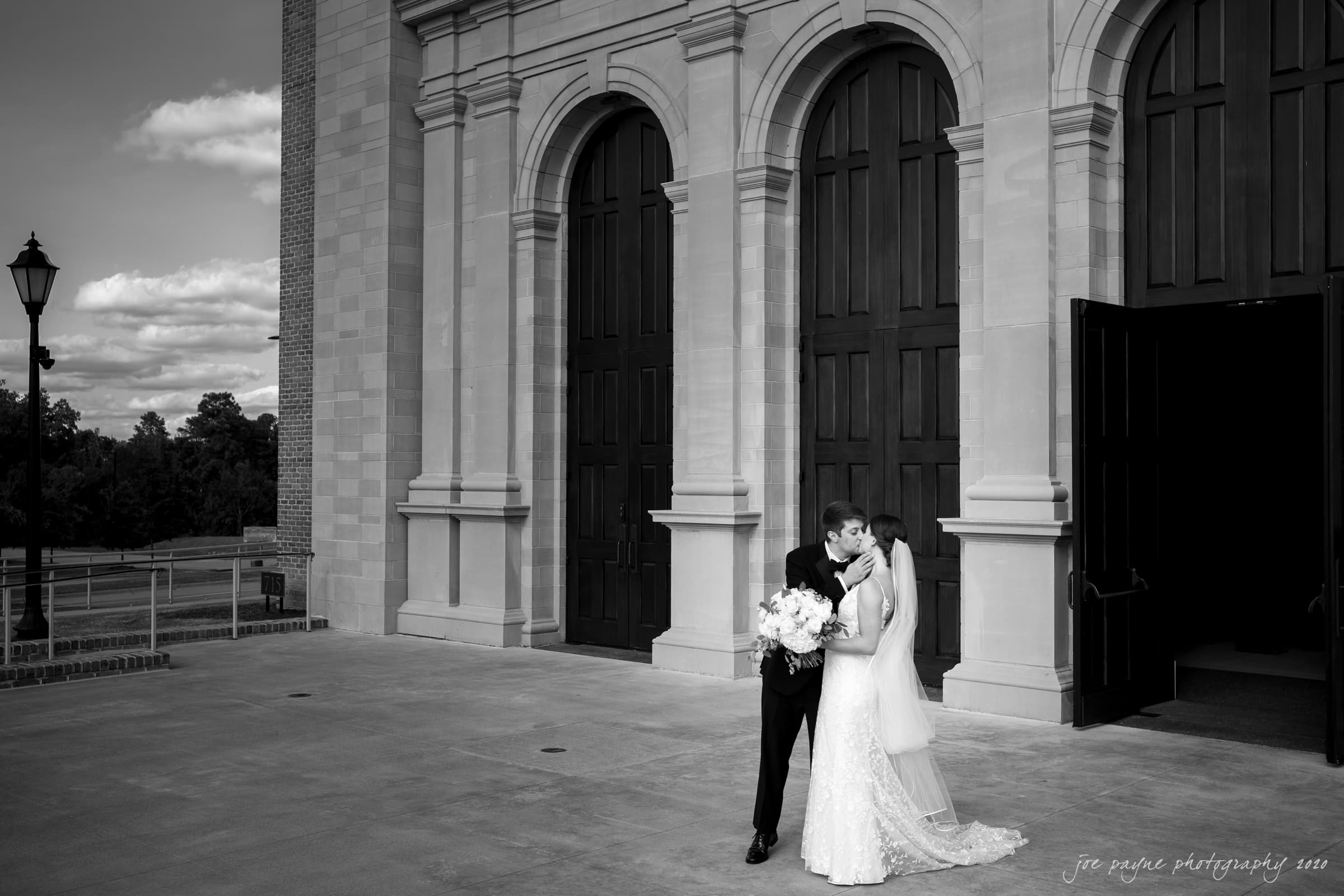 Holy Name of Jesus wedding photograph couple kiss outside B&W