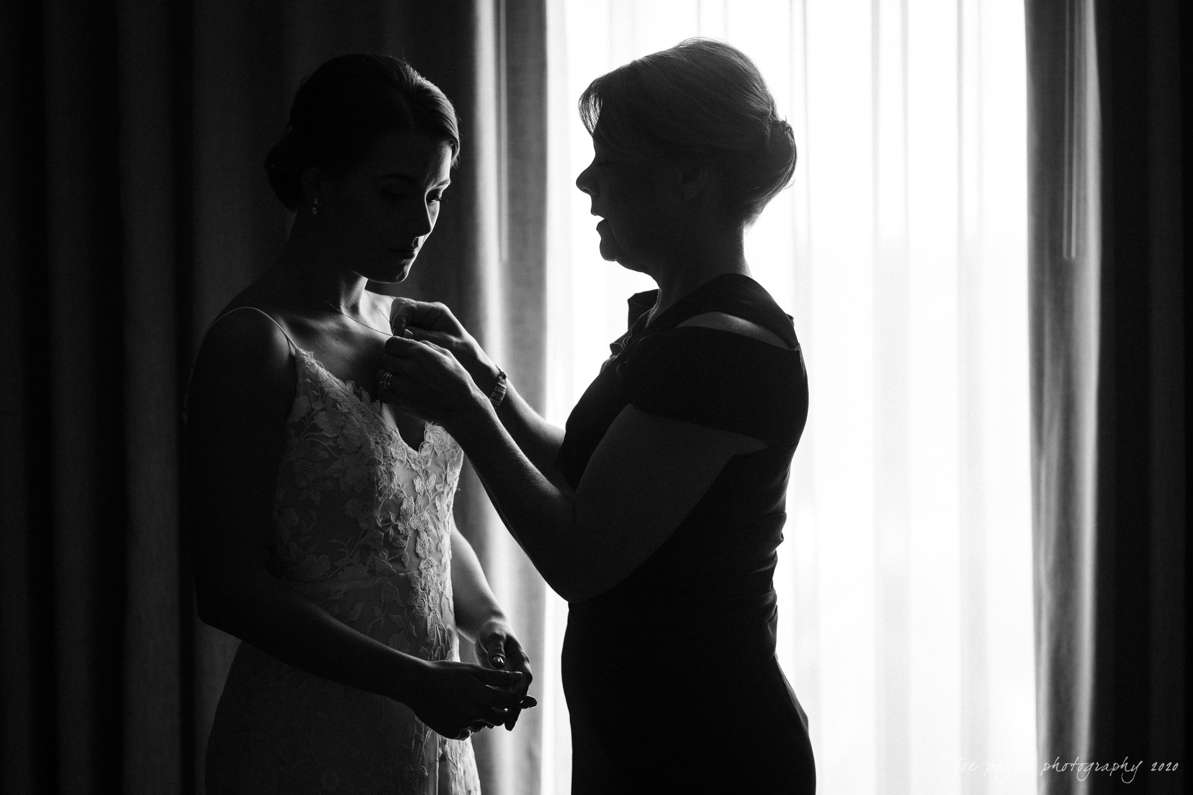 holy name of jesus & angus barn wedding - bride and mom prep in B&W