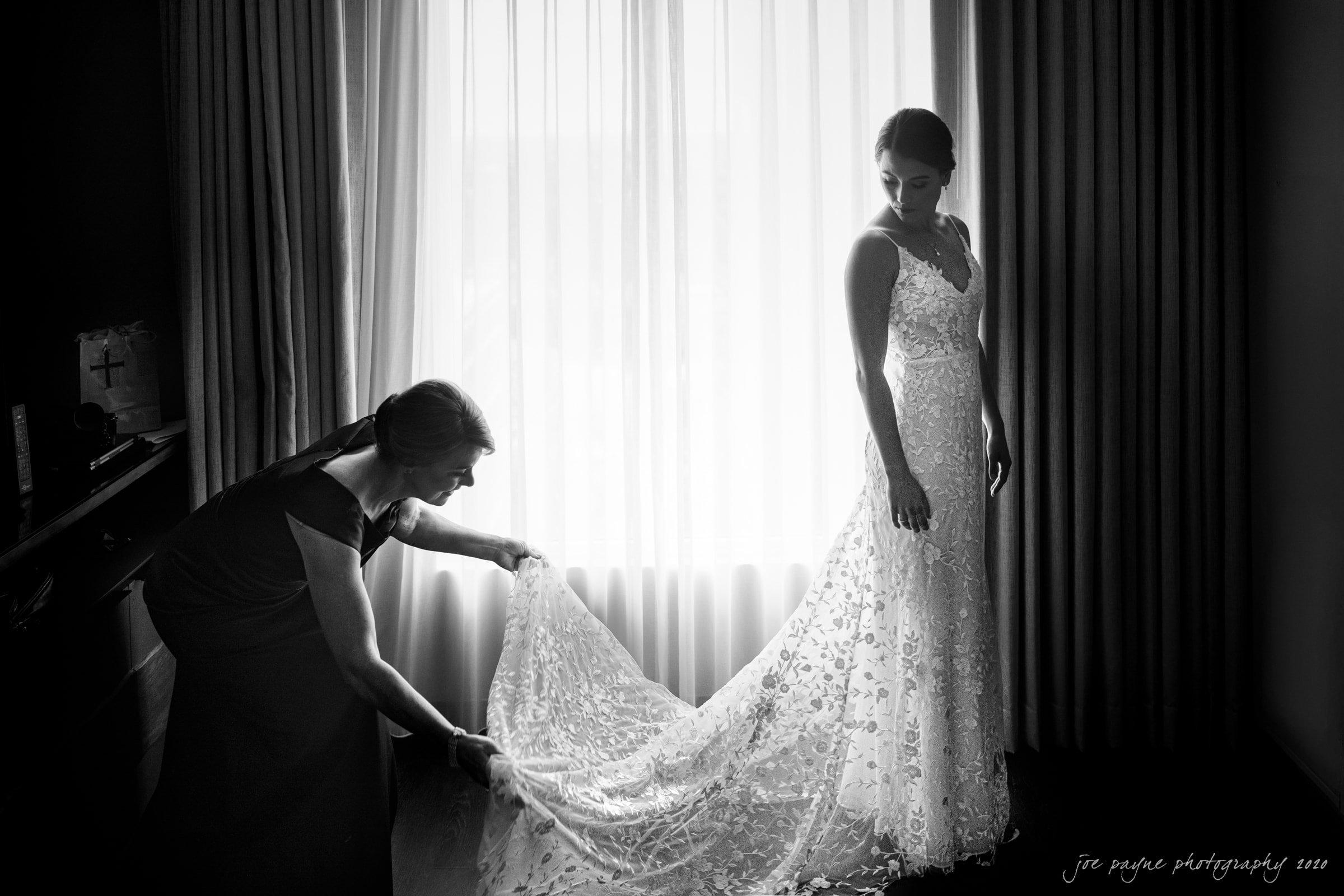 holy name of jesus & angus barn wedding - bride in dress