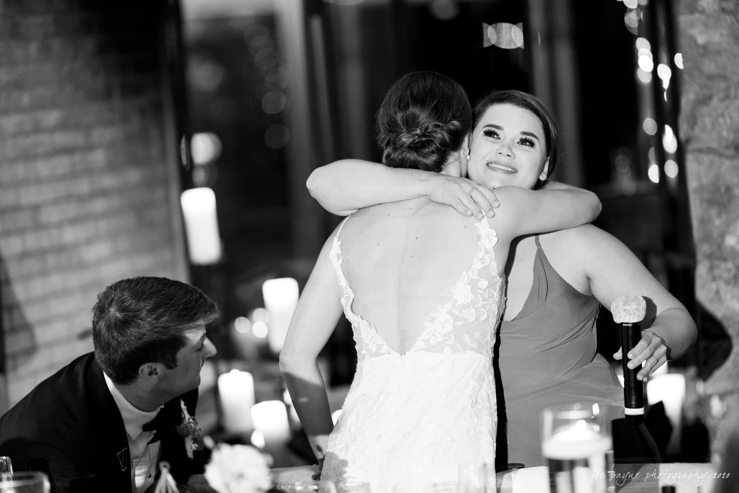 Pavilion at Angus Barn Wedding bride and sister hug