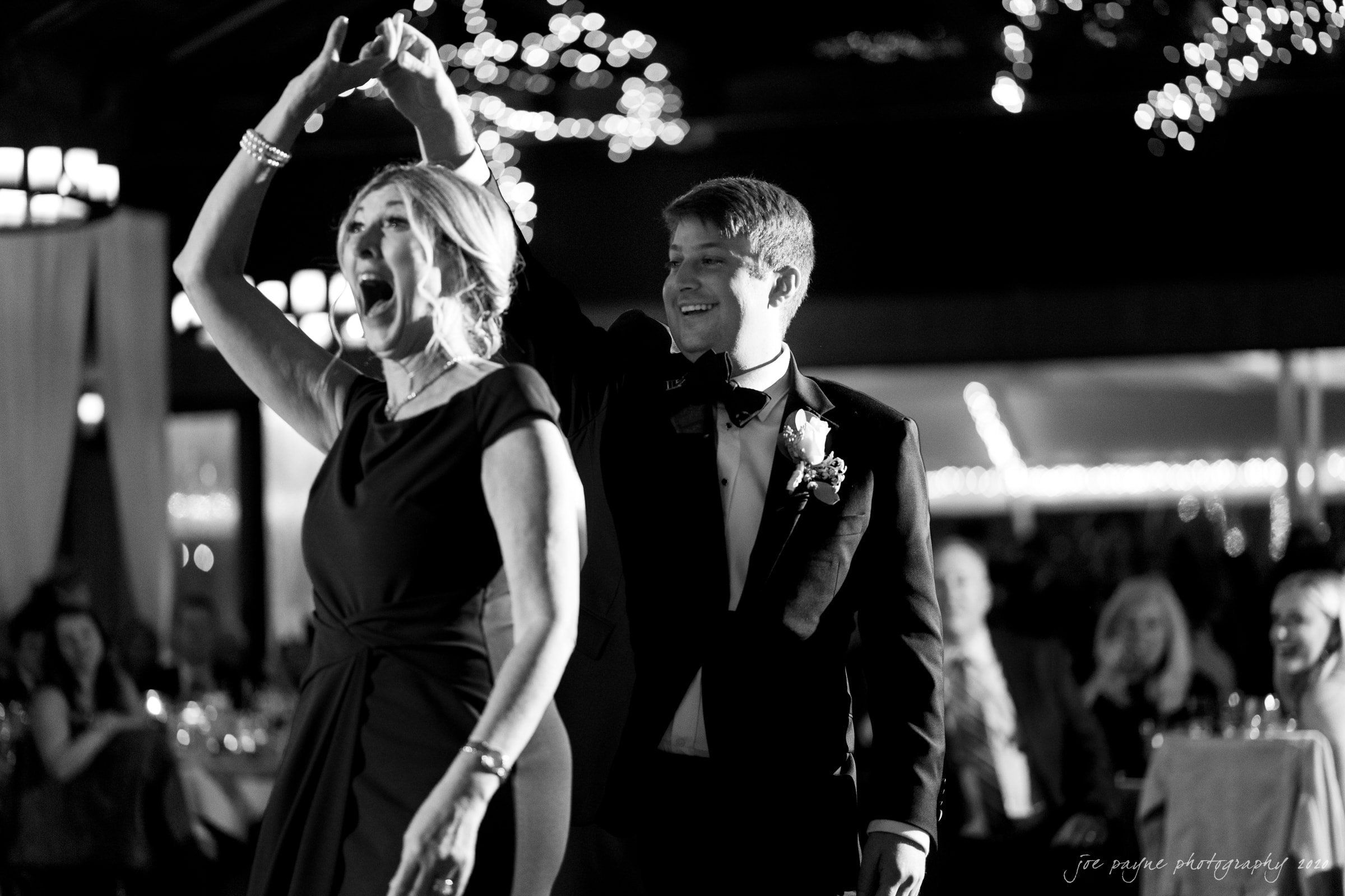 Pavilion at Angus Barn Wedding mother of groom parent dance laughing B&W