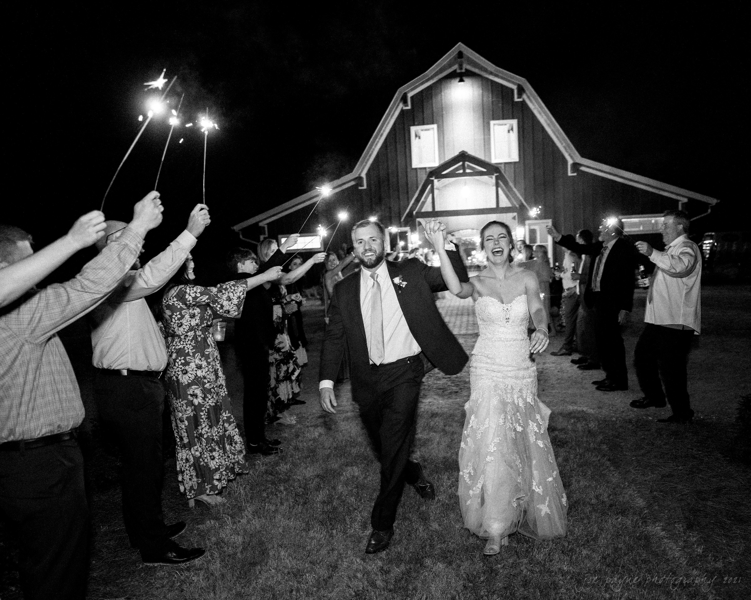 sacred heart church & pavilion at carriage farm wedding sparkler exit