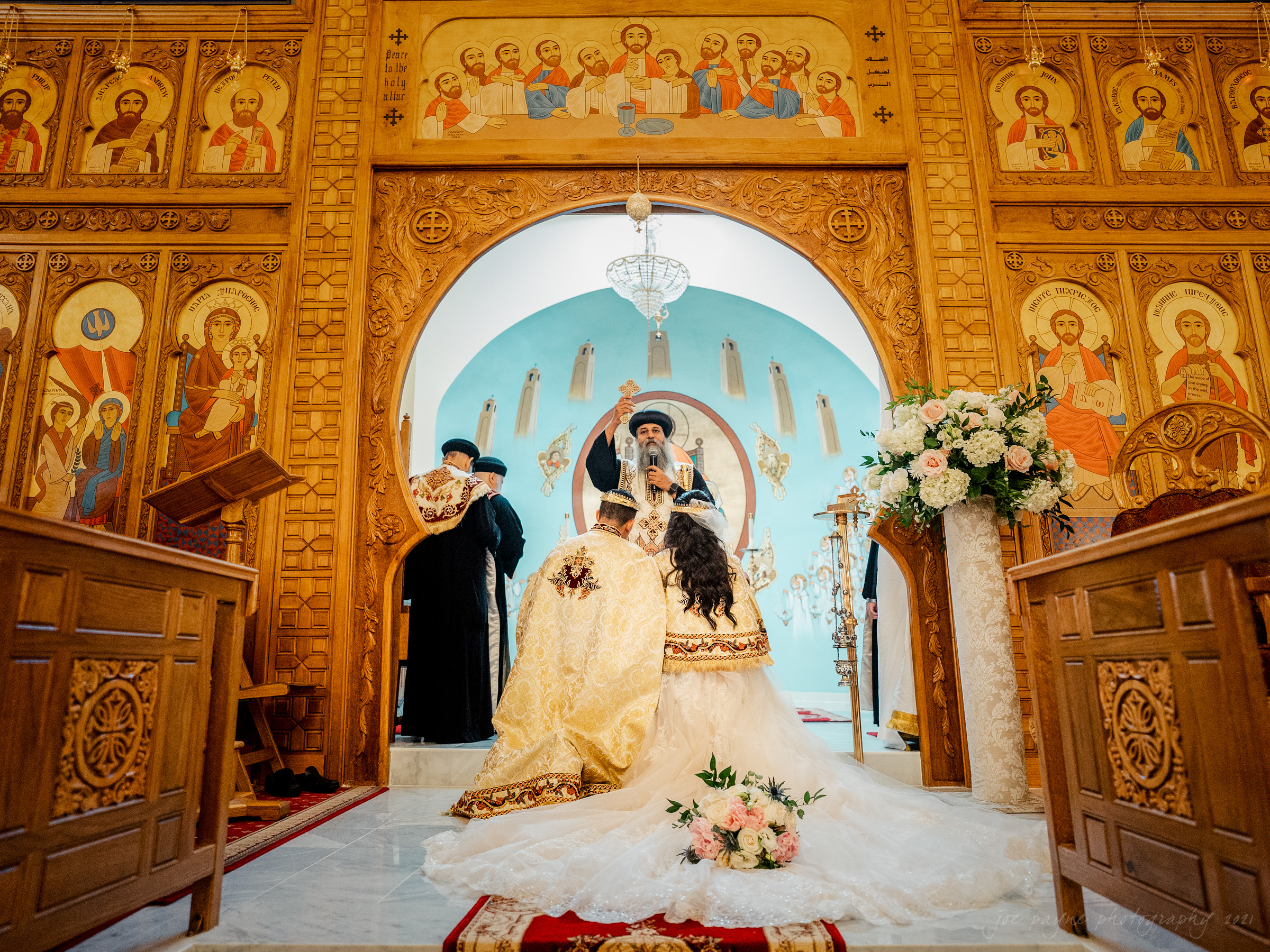 St Mary Coptic Orthodox Church wedding photo of couple at altar